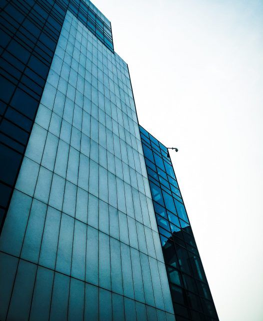 low-angle-photo-of-curtain-glass-wall-building-2408213